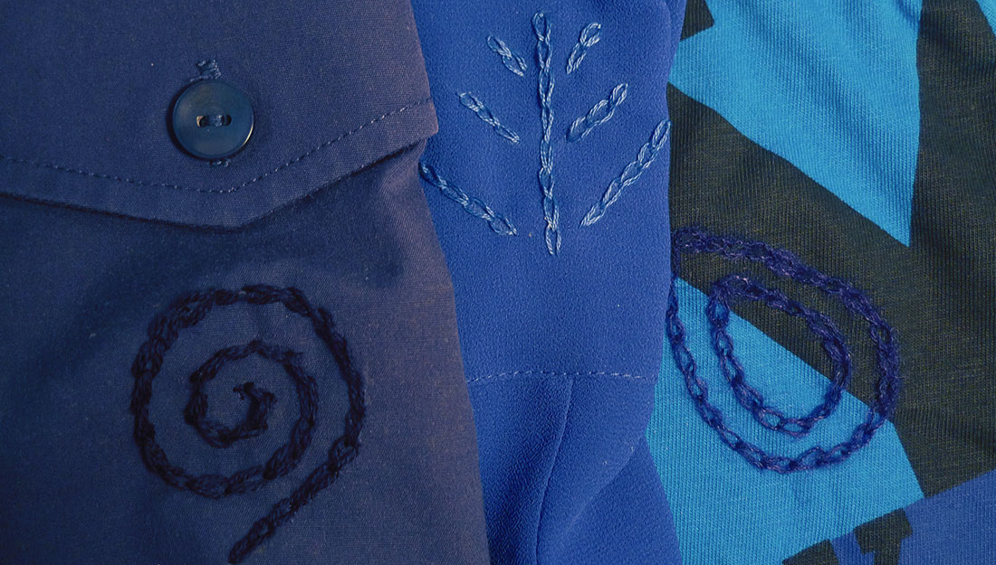 embroidery designs in blue thread on blue clothes.