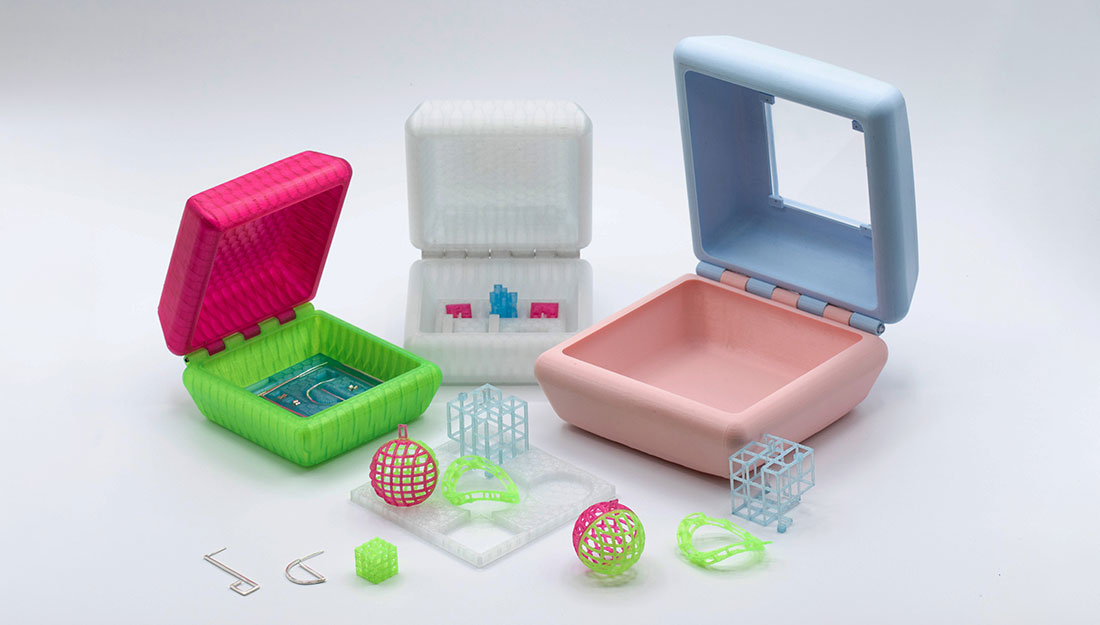 Some 3D printed boxes with geometric jewellery.