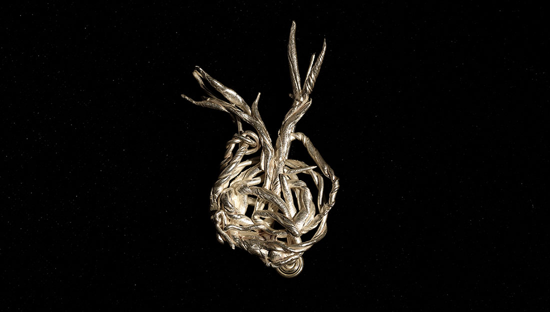 An abtract metal form made of twisted branchlike forms.