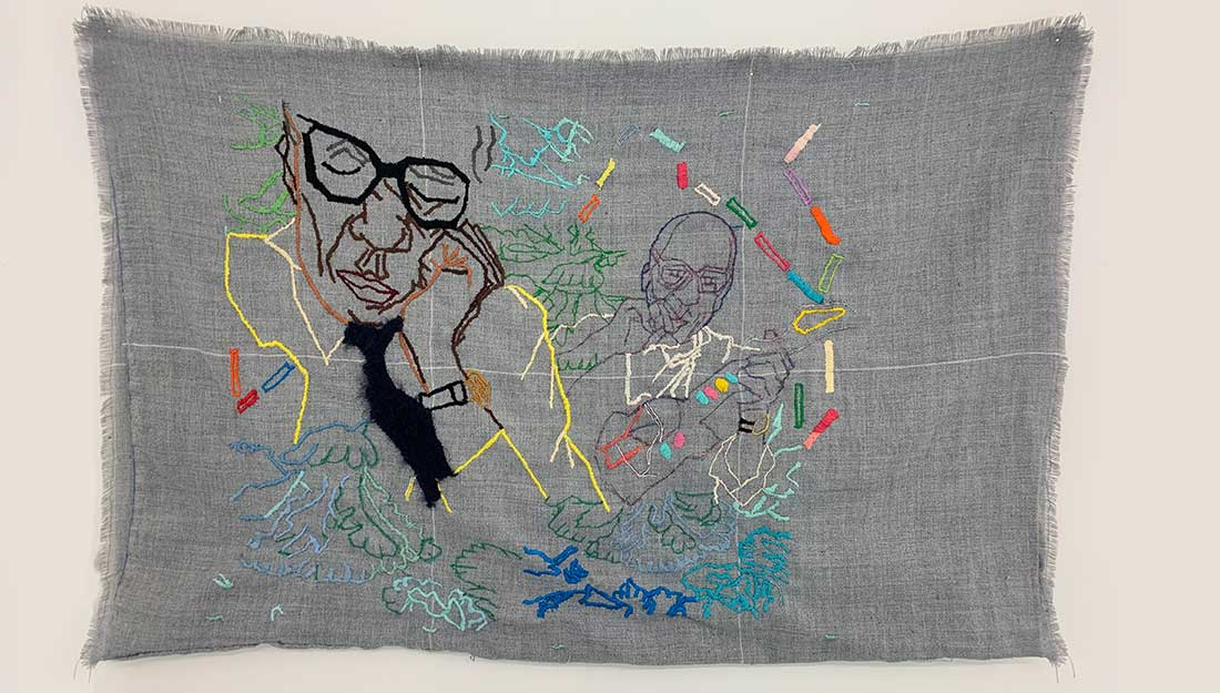 A large textile embroidery with portraits.