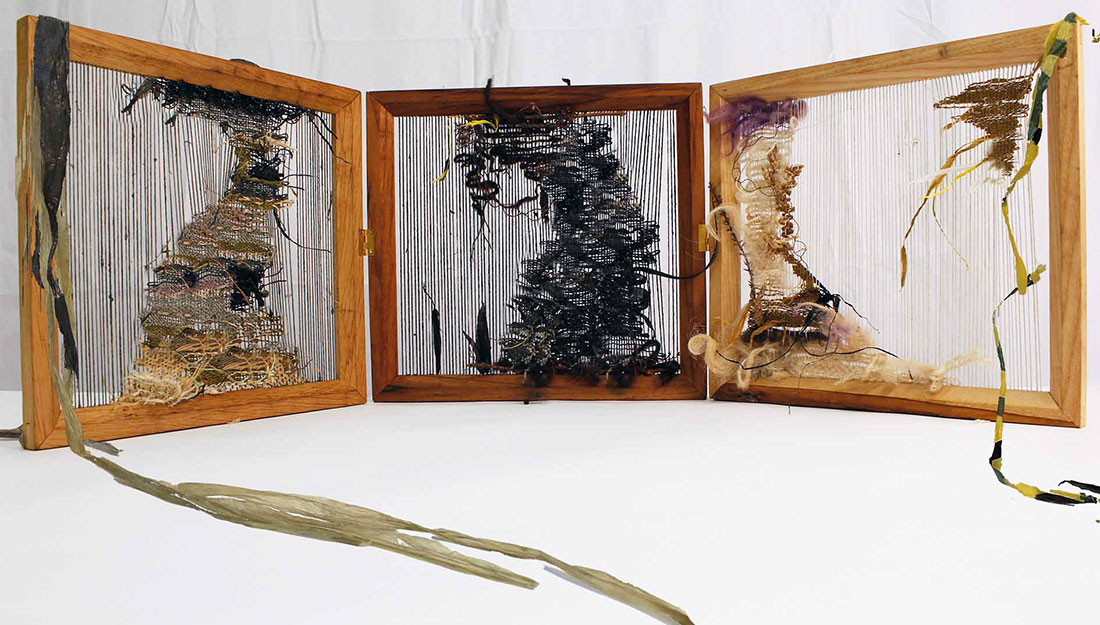 three wooden frames with absract woven pieces made from waste plastic.