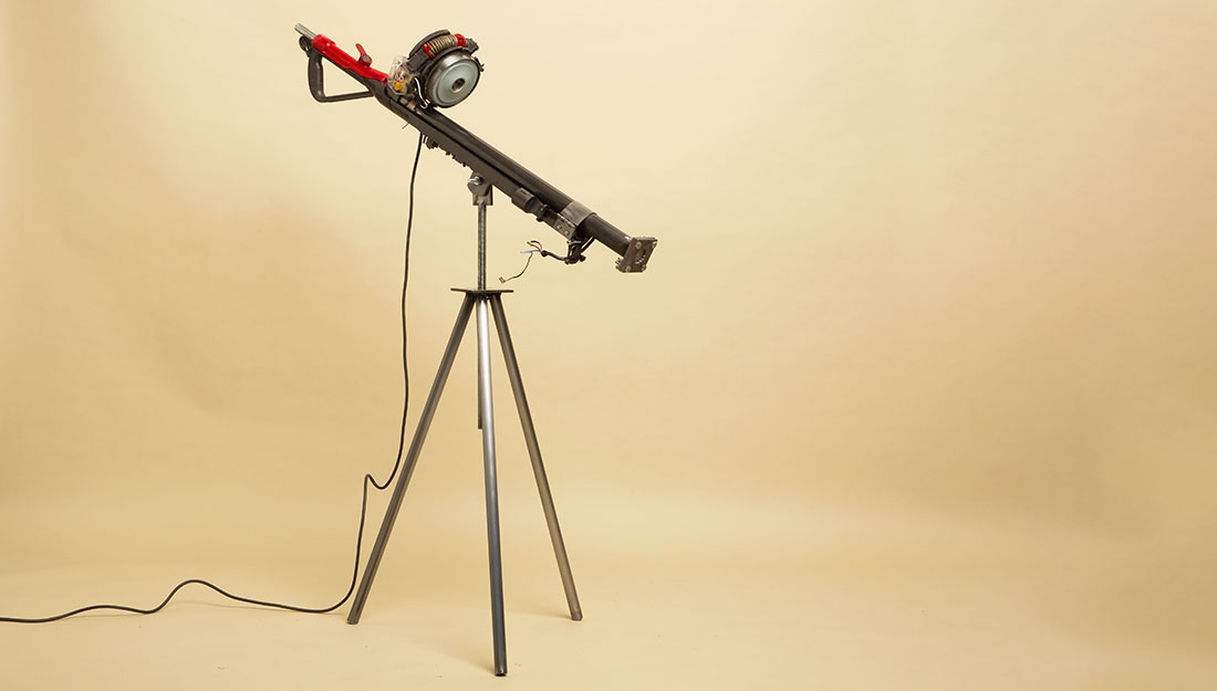 a contstructed machine stands on a tripod