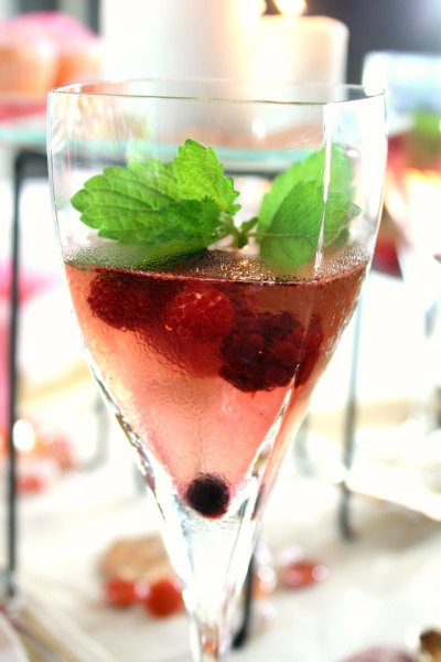 Mixed berry sangria garnished with lemon balm