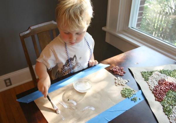 Child doing bean crafts