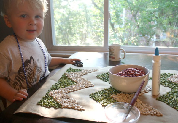 Child helping with bean art