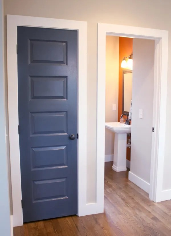 Navy blue door with orange accents