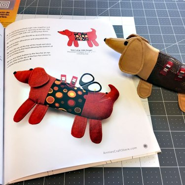 Dog pincushion checking her work