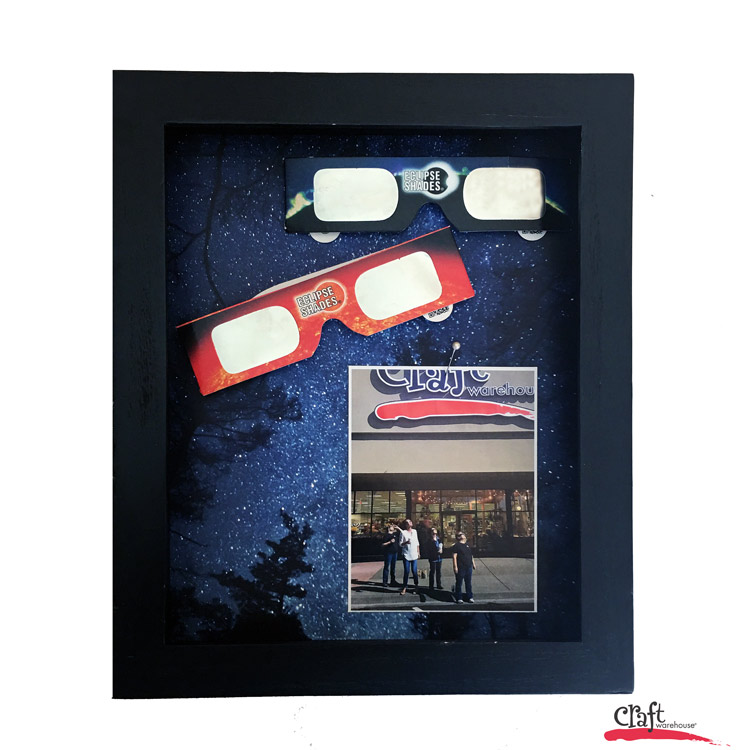 Make this souvenir eclipse shadowbox