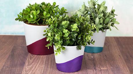 Dazzling metallic paints on planter pots from deco arts