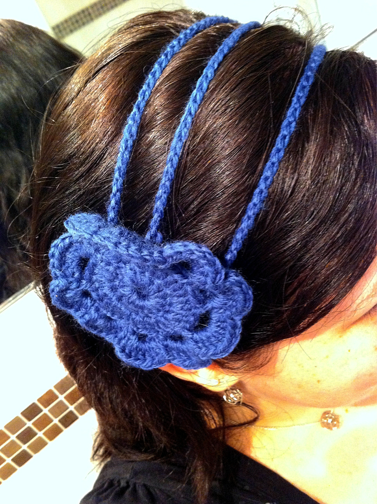 3-chain crochet headband with large flower in blue