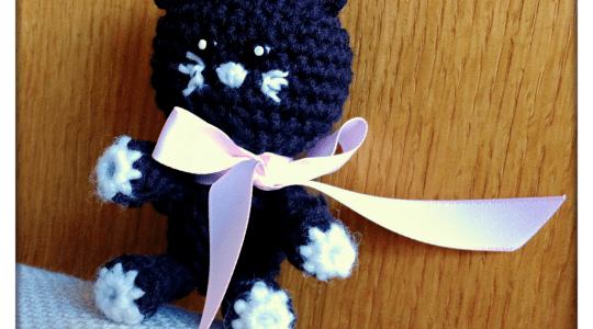 brown crocheted toy, looks like a cross between a bear, cat and mouse