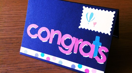 black congrats card with sticker decorations
