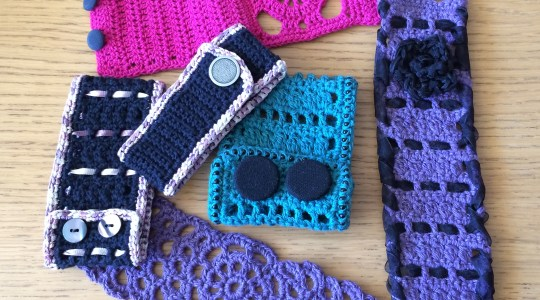black, green, purple and pink crochet cuffs