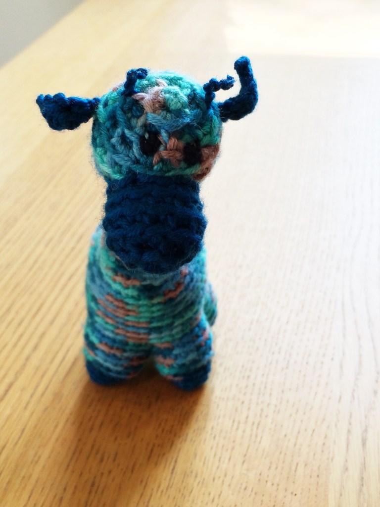 blue crocheted giraffe