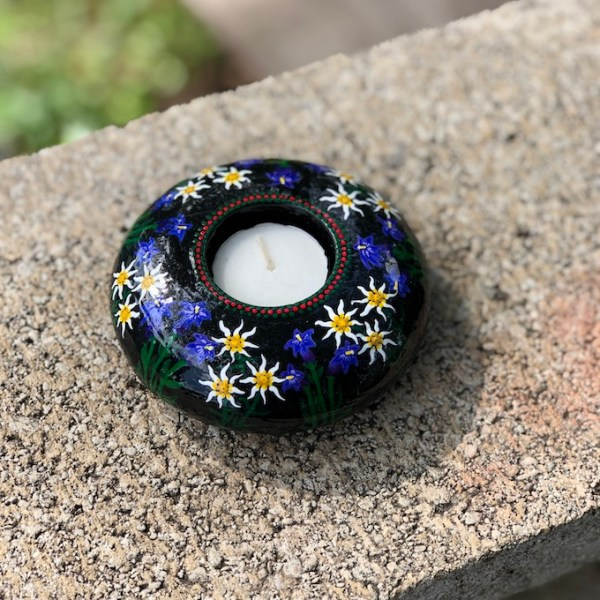 Hand cast, hand painted tea light holder with Edelweiss and Gentian Violet Design on wall