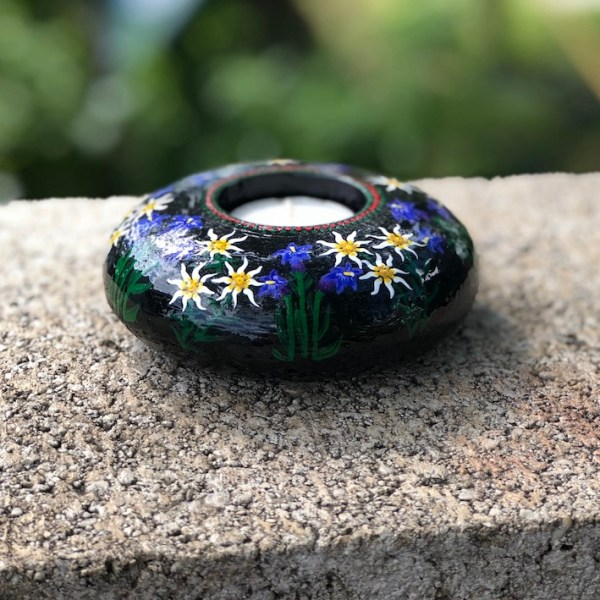 Hand cast, hand painted tea light holder with Edelweiss and Gentian Violet Design side view