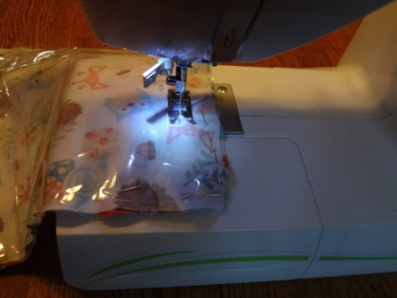 Sewing through the cellophane makes a delightful popping sound.