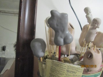 Body and head in Sculpey Firm over Styrofoam. You MUST use the floral foam so that it has something to cling to. (that foam is rough even after shaped)