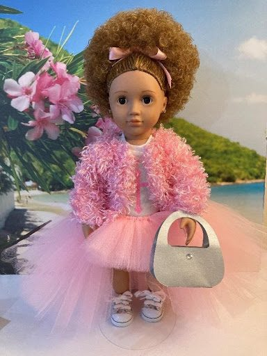 Online Craft Business Black Dollz Rock light-skinned doll dressed in pink tutu skirt, pink and white sneakers, pink furry jacket, white shirt with pink cross, pink hair ribbon curly afro, white purse.