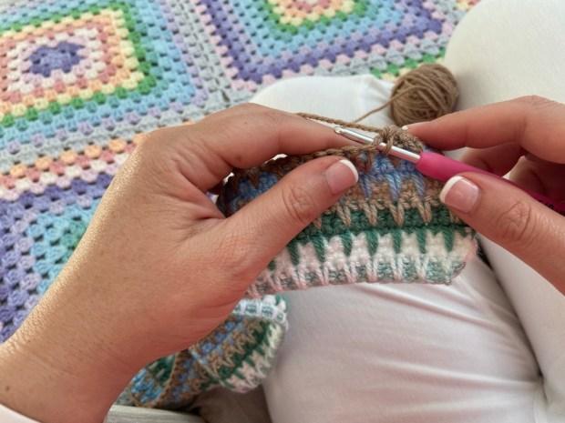 two hands crochet hook yarn