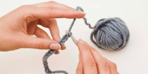 Two hands crocheting chain stitch Beginner crochet lessons