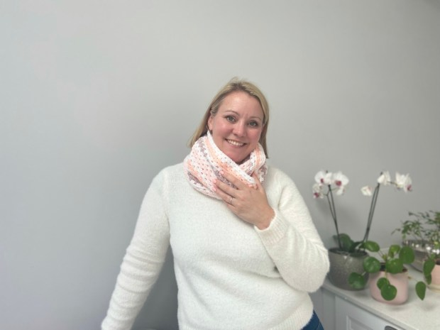 crochet teacher wearing an infinity scarf