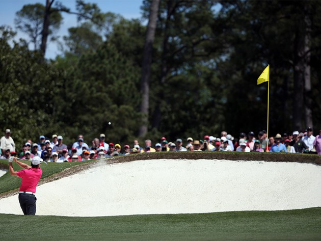 Rory McIlroy hits from the fairway bunker on No. 2 during the final round of the 2011 Masters Tournament