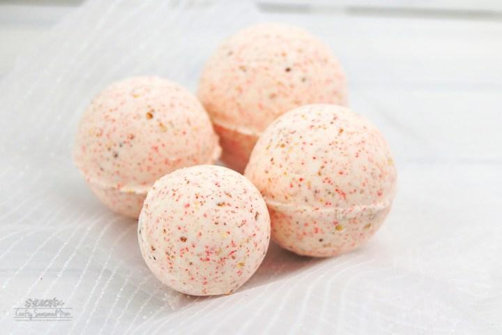 4 Vegan Friendly Orange Peel Bath Bombs on white gauze fabric