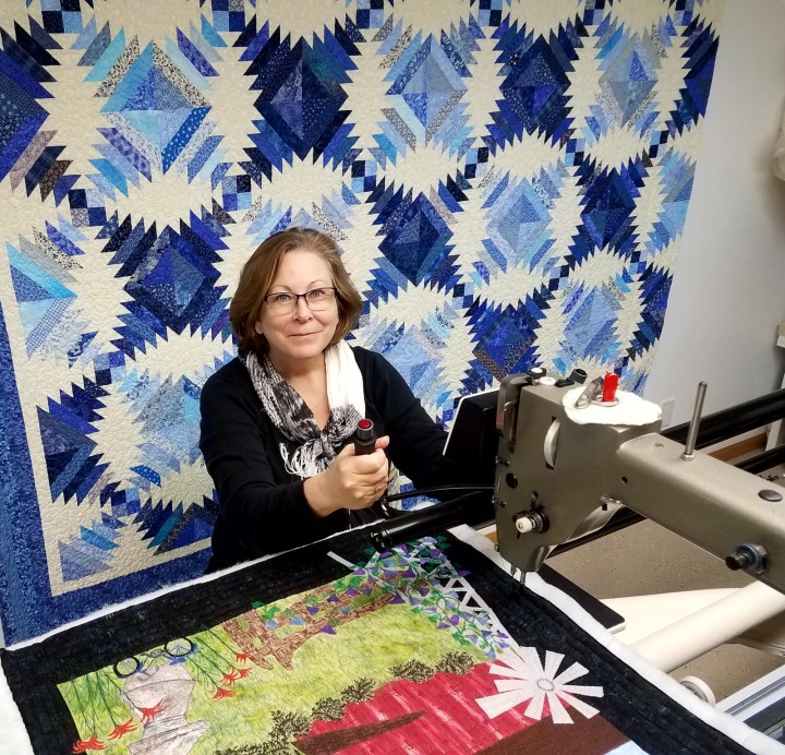 picture of Marcia in her quilting studio