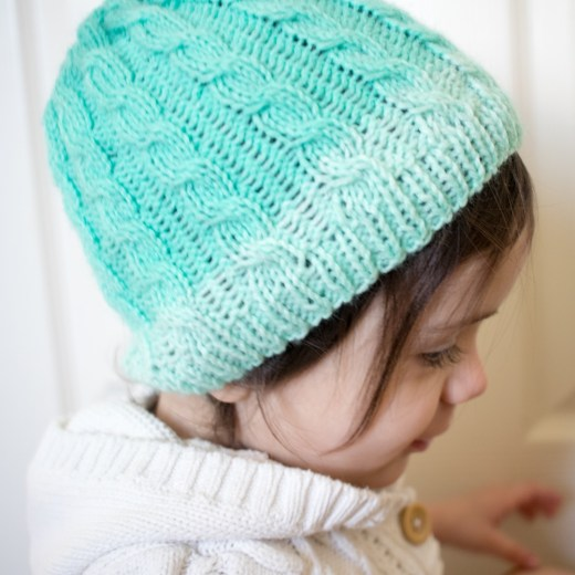 Knitted cabled hat