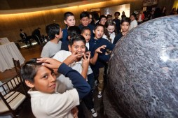 During a celebration of the rebranding of Core Academy, Powered by the Rogers Foundation, last November, students are intrigued by a big blue marble earth science exhibit at Springs Preserve. (Courtesy Rogers Foundation)