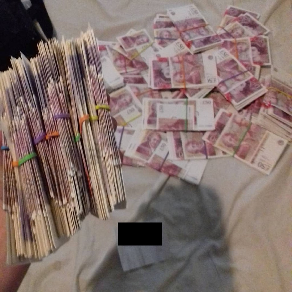 low quality photograph of money