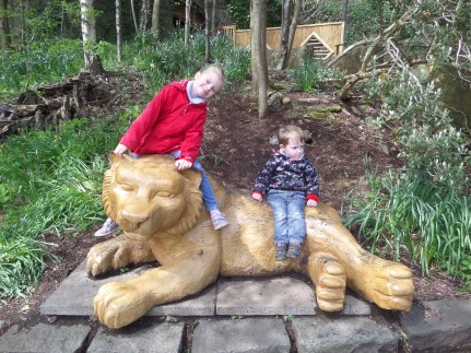 Ellie and Ben on a Lion