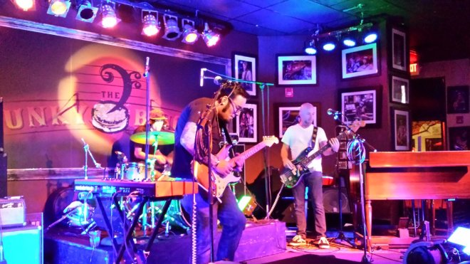 Patrick Farinas leads The Flyers on a rocking Tuesday at the Funky Biscuit, backed by Joe Beard on bass and Jordan Richards on drums. They swap places and instruments frequently. Craigslegz.com