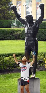 A runner strikes the cliche pose with the Rocky statue in Philadelphia. Craigslegz.com
