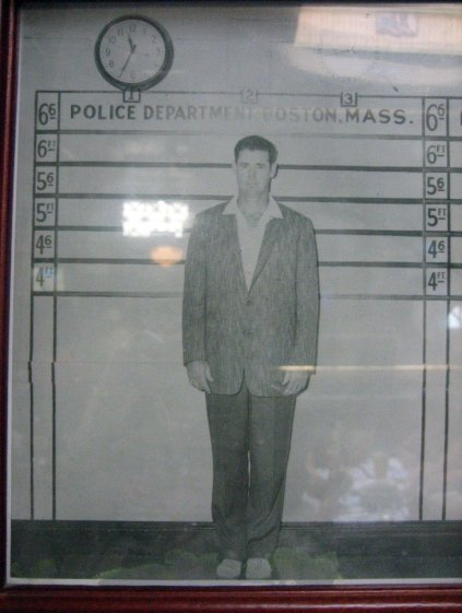 Photo of Ted Williams posing for a Boston police mug shot as a gag is on display at Doyle's Cafe in Boston. Craigslegz.com