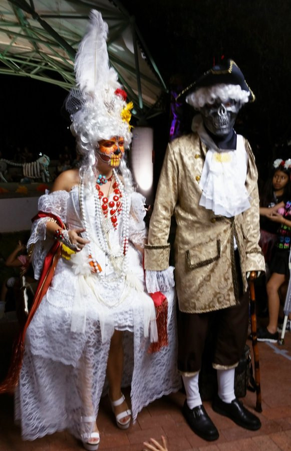 Some Day of the Dead celebrants come in elaborate costumes. Craig Davis/Craigslegz.com