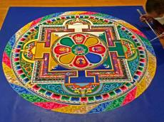 Last year, the theme of the mandala done at the tour was healing;this year, the museum chose compassion as the theme. The mandala really represents an aerial view of a specific Buddha dwelling, in this case, the Temple of Compassion. the four rectangular sections represent doorways. — at Coral Springs Center For The Arts.