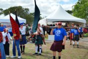 Competitors carry the caber at the Southeast Florida Highland Games, (Craig Davis/Craigslegz.com)