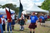 Competitors carry the caber at the Southeast Florida Highland Games, (Craig Davis/Craigslegz.com)