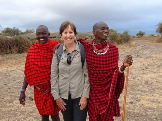 Terry Gereffi accompanied by residents of a Masai Mara village in Kenya. (Courtesy/Paul Gereffi)