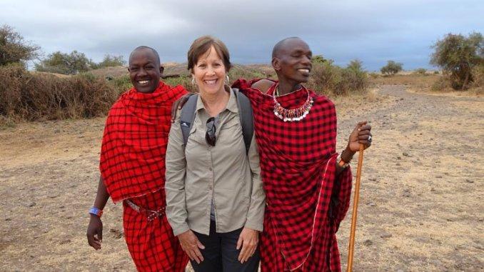 Terry Gereffi accompanied by residents of a Masai Mara village in Kenya. (Courtesy/Paul Gereffi)
