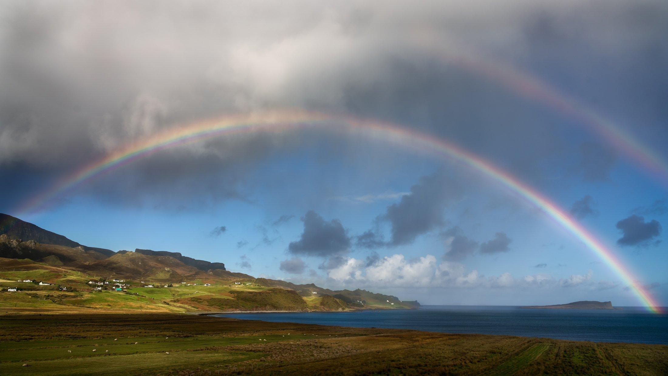 A double rainbow arcs above the Isle of Skye, one of many seen during the photo tour. (Glenn Davis/glenndavisphotography.com)