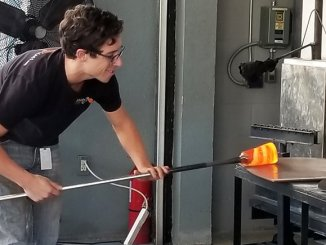 Richard Dextraze shapes a glass tumbler at Hollywood Hot Glass in Hollywood, Fla. (Craig Davis, Craigzlegztravels.com)