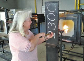 Furnaces with temperatures of more than 2,000 degrees keeps the molten glass pliable for glass sculpting. (Craig Davis/Craigslegztravels.com)