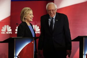 Hillary Clinton, former Secretary of State and 2016 Democratic presidential candidate, left, and Senator Bernie Sanders, an independent from Vermont and 2016 Democratic presidential candidate, talk after the Democratic presidential candidate debate in Charleston, South Carolina, U.S., on Sunday, Jan. 17, 2016. Hours before Sunday's Democratic debate, the two top Democratic contenders held a warm-up bout of sorts in multiple separate appearances on political talk shows, at a time when the polling gap between the pair has narrowed in early-voting states. Photographer: Patrick T. Fallon/Bloomberg via Getty Images