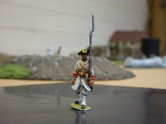 French Grenadier in tricorne marching.