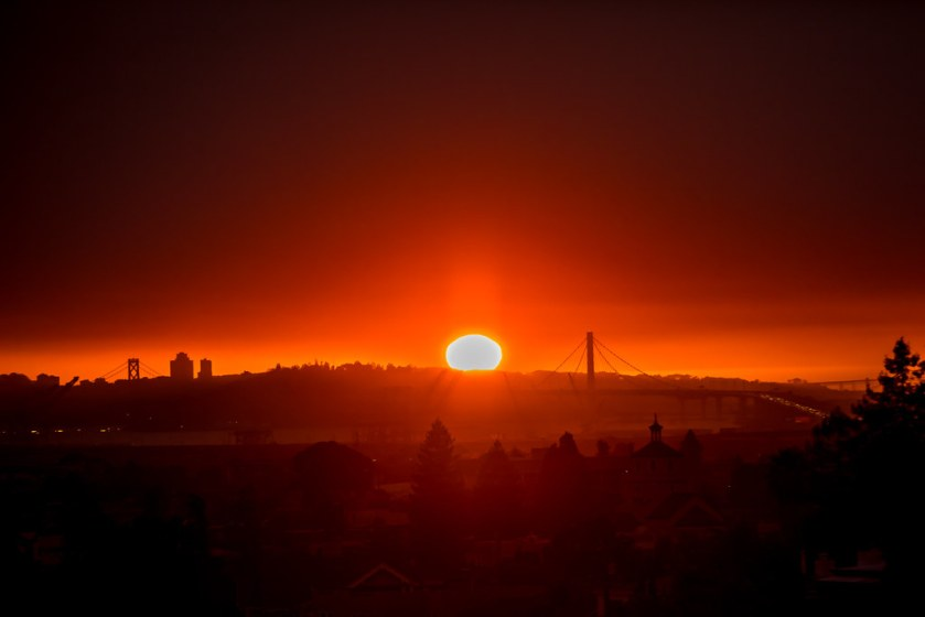Red sunset over Oakland, CA during wildfire season.