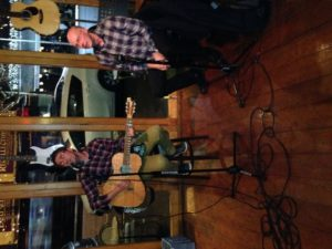 Torjer Olsen, with guitar, and Simon tackle Springsteen's Promised Land at a Ponsonby cafe last year