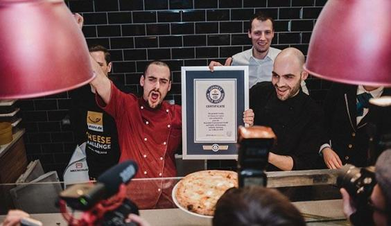 Berlin chef bakes cheesiest pizza in the world with 111 different types of cheese